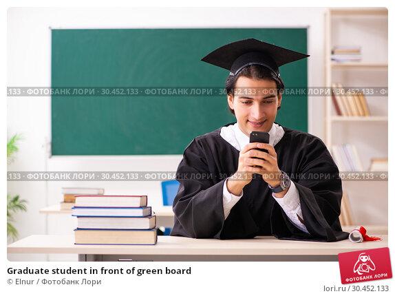 Graduate student in front of green board. Стоковое фото, фотограф Elnur / Фотобанк Лори