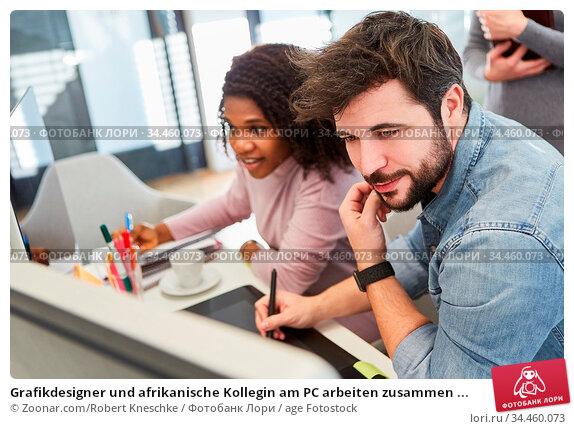 Grafikdesigner und afrikanische Kollegin am PC arbeiten zusammen ... Стоковое фото, фотограф Zoonar.com/Robert Kneschke / age Fotostock / Фотобанк Лори