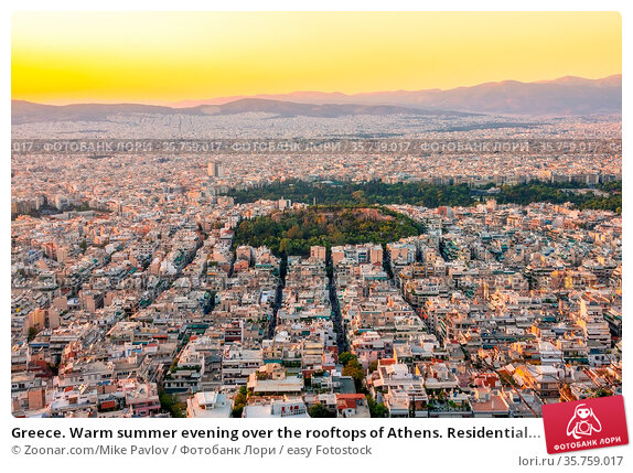 Greece. Warm summer evening over the rooftops of Athens. Residential... Стоковое фото, фотограф Zoonar.com/Mike Pavlov / easy Fotostock / Фотобанк Лори