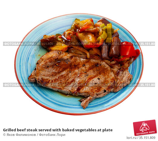 Grilled beef steak served with baked vegetables at plate. Стоковое фото, фотограф Яков Филимонов / Фотобанк Лори