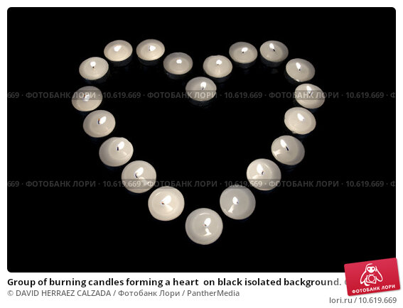 Group of burning candles forming a heart  on black isolated background. Concept for St. Valentine. Стоковое фото, фотограф DAVID HERRAEZ CALZADA / PantherMedia / Фотобанк Лори