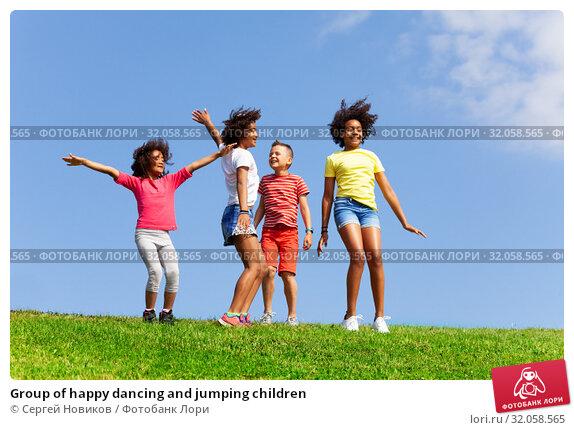 Group of happy dancing and jumping children. Стоковое фото, фотограф Сергей Новиков / Фотобанк Лори