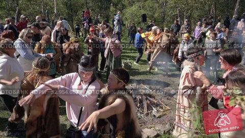 Group of people joyfully sing songs and dance near fire. Itelmens traditional national ritual festival thanksgiving nature Alhalalalay. Kamchatka Peninsula (2019 год). Редакционное видео, видеограф А. А. Пирагис / Фотобанк Лори