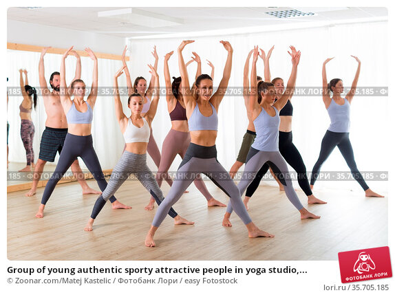 Group of young authentic sporty attractive people in yoga studio,... Стоковое фото, фотограф Zoonar.com/Matej Kastelic / easy Fotostock / Фотобанк Лори