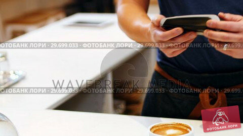 Купить «Hand of customer making payment through smartwatch», видеоролик № 29699033, снято 17 января 2017 г. (c) Wavebreak Media / Фотобанк Лори