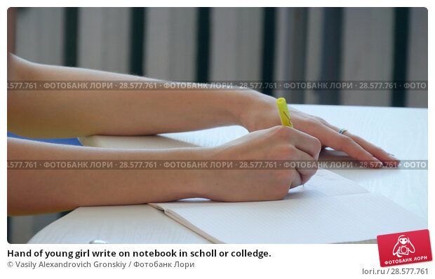 Купить «Hand of young girl write on notebook in scholl or colledge.», фото № 28577761, снято 25 июня 2018 г. (c) Vasily Alexandrovich Gronskiy / Фотобанк Лори