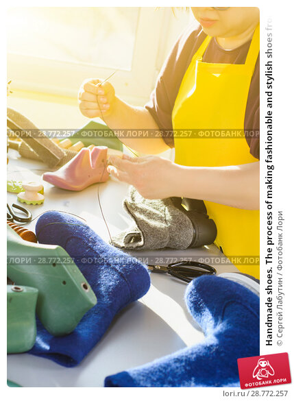 Купить «Handmade shoes. The process of making fashionable and stylish shoes from natural felted wool.», фото № 28772257, снято 31 января 2018 г. (c) Сергей Лабутин / Фотобанк Лори