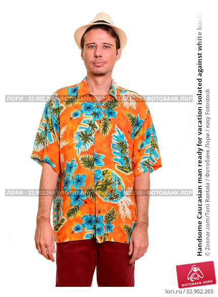 Handsome Caucasian man ready for vacation isolated against white background. Стоковое фото, фотограф Zoonar.com/Toni Rantala / easy Fotostock / Фотобанк Лори
