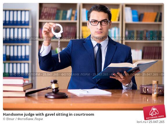 Купить «Handsome judge with gavel sitting in courtroom», фото № 25047265, снято 3 ноября 2016 г. (c) Elnur / Фотобанк Лори