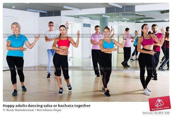Happy adults dancing salsa or bachata together. Стоковое фото, фотограф Яков Филимонов / Фотобанк Лори