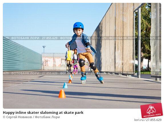Купить «Happy inline skater slaloming at skate park», фото № 27855629, снято 14 октября 2017 г. (c) Сергей Новиков / Фотобанк Лори