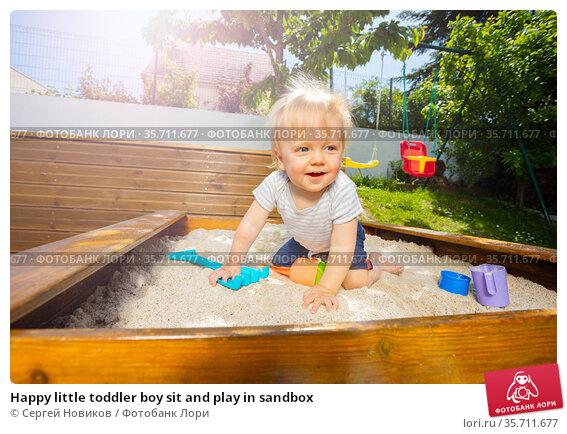 Happy little toddler boy sit and play in sandbox. Стоковое фото, фотограф Сергей Новиков / Фотобанк Лори