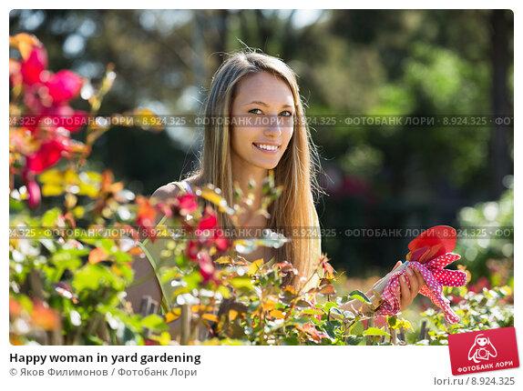 Купить «Happy woman in yard gardening», фото № 8924325, снято 5 июня 2014 г. (c) Яков Филимонов / Фотобанк Лори