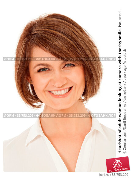 Headshot of adult woman looking at camera with toothy smile. Isolated... Стоковое фото, фотограф Zoonar.com/Danil Roudenko / age Fotostock / Фотобанк Лори