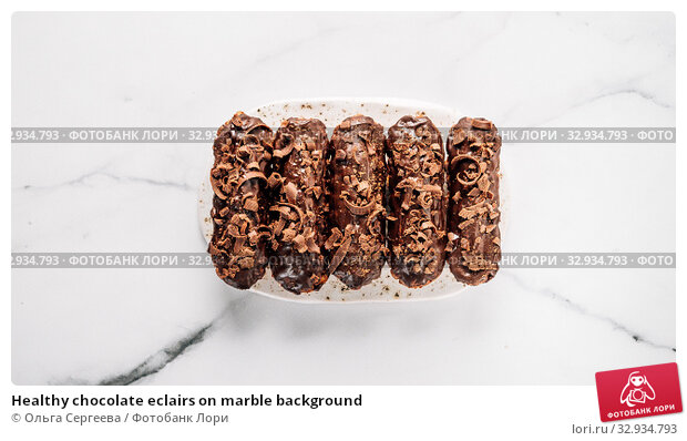 Купить «Healthy chocolate eclairs on marble background», фото № 32934793, снято 19 августа 2019 г. (c) Ольга Сергеева / Фотобанк Лори