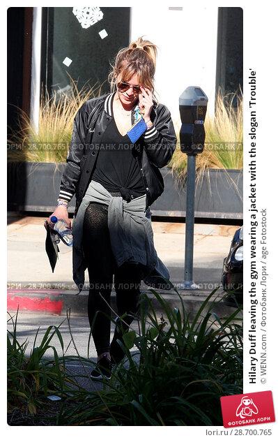 Купить «Hilary Duff leaving the gym wearing a jacket with the slogan 'Trouble' Featuring: Hilary Duff Where: Los Angeles, California, United States When: 28 Dec 2016 Credit: WENN.com», фото № 28700765, снято 28 декабря 2016 г. (c) age Fotostock / Фотобанк Лори