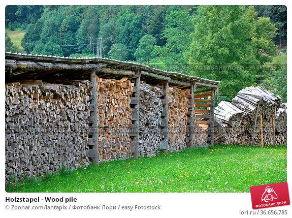 Holzstapel - Wood pile. Стоковое фото, фотограф Zoonar.com/lantapix / easy Fotostock / Фотобанк Лори