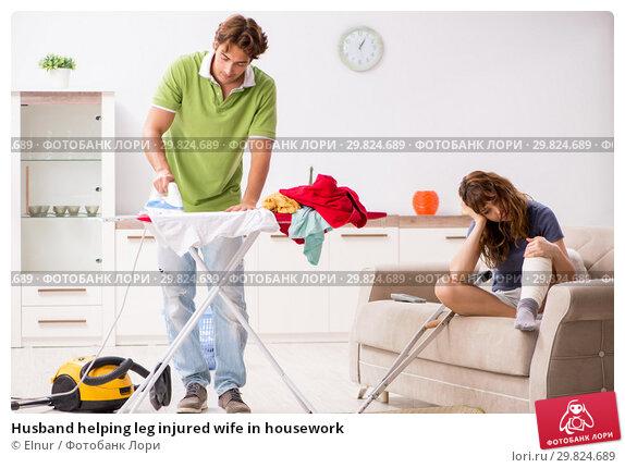 Купить «Husband helping leg injured wife in housework», фото № 29824689, снято 4 октября 2018 г. (c) Elnur / Фотобанк Лори