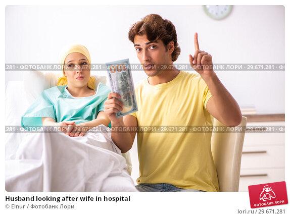 Купить «Husband looking after wife in hospital», фото № 29671281, снято 3 октября 2018 г. (c) Elnur / Фотобанк Лори