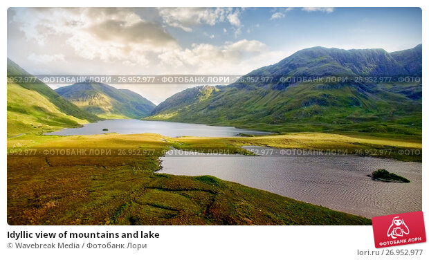 Купить «Idyllic view of mountains and lake», фото № 26952977, снято 13 декабря 2017 г. (c) Wavebreak Media / Фотобанк Лори