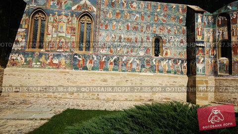 Купить «Image of frescoes of church in Sucevita Monastery on Bucovina in Romania.», видеоролик № 27385409, снято 7 октября 2017 г. (c) Яков Филимонов / Фотобанк Лори
