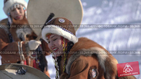 Купить «Indigenous female dancing with tambourine in traditional clothing native people», видеоролик № 33269477, снято 22 февраля 2020 г. (c) А. А. Пирагис / Фотобанк Лори