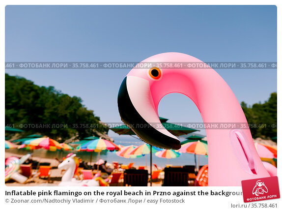 Inflatable pink flamingo on the royal beach in Przno against the background... Стоковое фото, фотограф Zoonar.com/Nadtochiy Vladimir / easy Fotostock / Фотобанк Лори