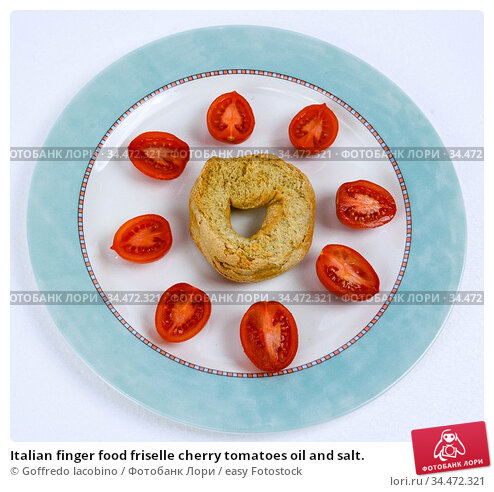 Italian finger food friselle cherry tomatoes oil and salt. Стоковое фото, фотограф Goffredo Iacobino / easy Fotostock / Фотобанк Лори