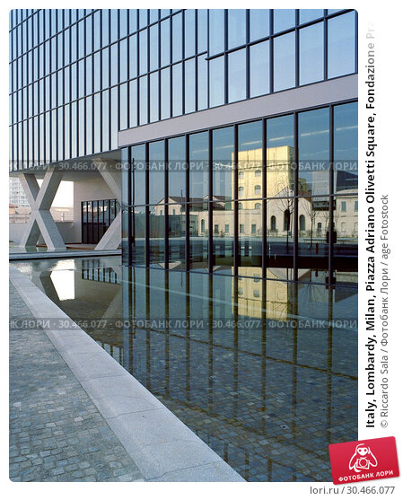Italy, Lombardy, Milan, Piazza Adriano Olivetti Square, Fondazione Prada Foundation Reflected in the Window Building.. Редакционное фото, фотограф Riccardo Sala / age Fotostock / Фотобанк Лори