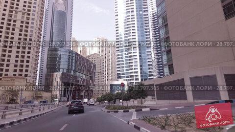 Купить «Journey on the roads among the skyscrapers of the fashionable district Dubai Marina stock footage video», видеоролик № 28797305, снято 8 апреля 2018 г. (c) Юлия Машкова / Фотобанк Лори