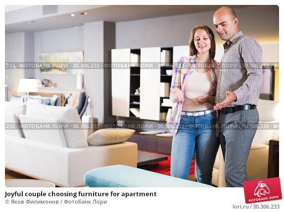 Купить «Joyful couple choosing furniture for apartment», фото № 30306233, снято 16 мая 2017 г. (c) Яков Филимонов / Фотобанк Лори