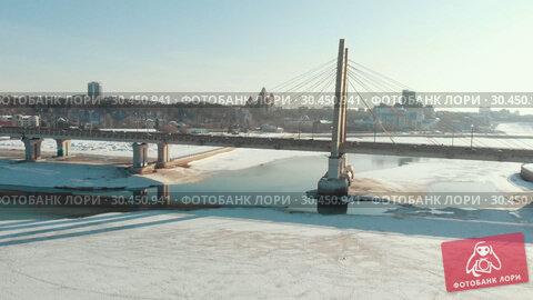 KAZAN, RUSSIA. 16-03-2019: An aerial view on the famous urban bridge at winter time. Редакционное видео, видеограф Константин Шишкин / Фотобанк Лори