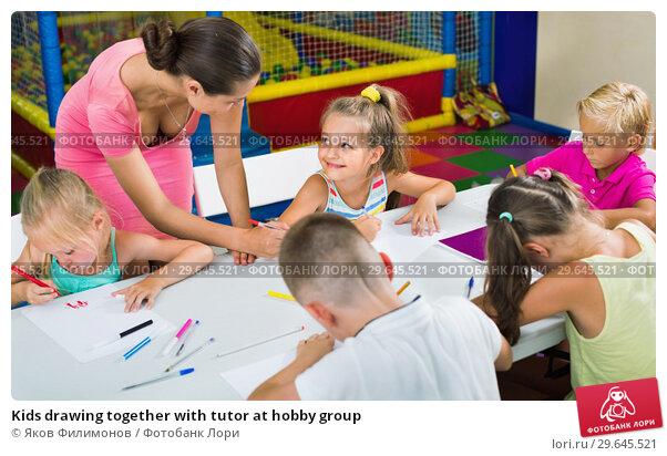 Купить «Kids drawing together with tutor at hobby group», фото № 29645521, снято 8 декабря 2019 г. (c) Яков Филимонов / Фотобанк Лори