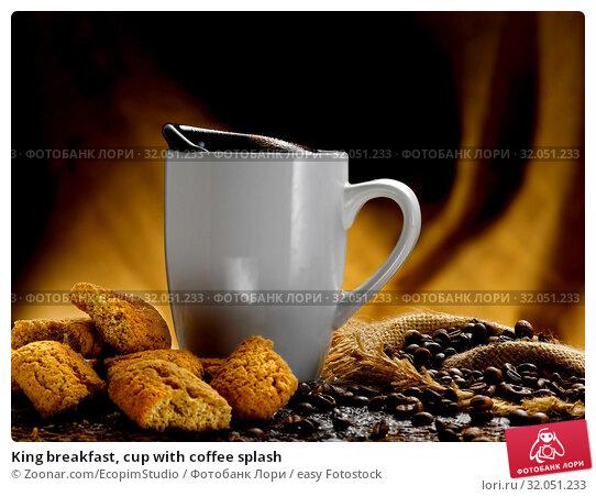 King breakfast, cup with coffee splash. Стоковое фото, фотограф Zoonar.com/EcopimStudio / easy Fotostock / Фотобанк Лори