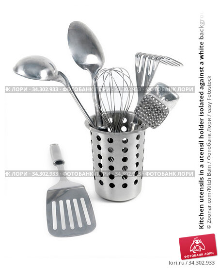 Kitchen utensils in a utensil holder isolated against a white background. Стоковое фото, фотограф Zoonar.com/Kitch Bain / easy Fotostock / Фотобанк Лори