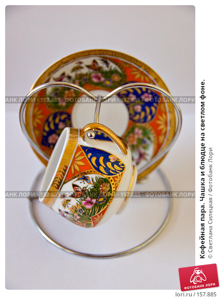 Кофейная пара. Чашка и блюдце на светлом фоне., фото № 157885, снято 24 декабря 2007 г. (c) Светлана Силецкая / Фотобанк Лори