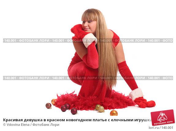 Красивая девушка в красном новогоднем платье с елочными игрушками на белом фоне, фото № 140001, снято 15 ноября 2007 г. (c) Vdovina Elena / Фотобанк Лори