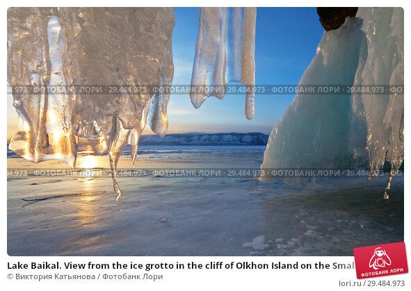 Купить «Lake Baikal. View from the ice grotto in the cliff of Olkhon Island on the Small Sea Strait at sunset. Beautiful winter landscape», фото № 29484973, снято 8 марта 2015 г. (c) Виктория Катьянова / Фотобанк Лори