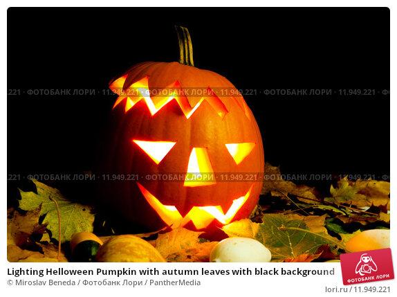 Купить «Lighting Helloween Pumpkin with autumn leaves with black background», фото № 11949221, снято 23 апреля 2019 г. (c) PantherMedia / Фотобанк Лори