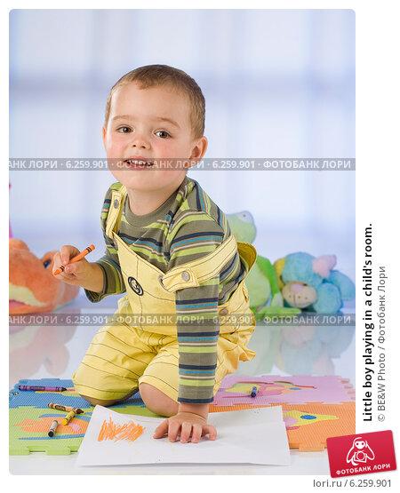 Купить «Little boy playing in a child's room.», фото № 6259901, снято 17 июля 2019 г. (c) BE&W Photo / Фотобанк Лори