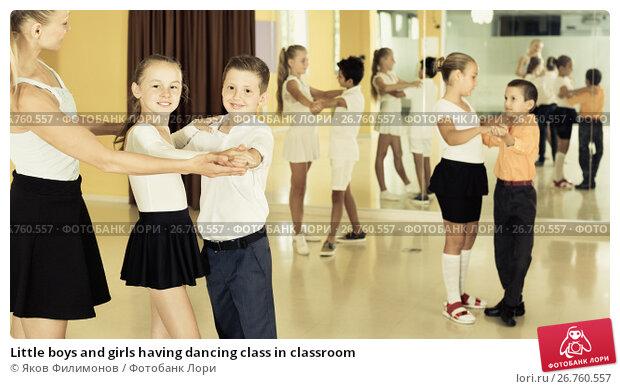 Little boys and girls having dancing class in classroom, фото № 26760557, снято 13 июля 2017 г. (c) Яков Филимонов / Фотобанк Лори