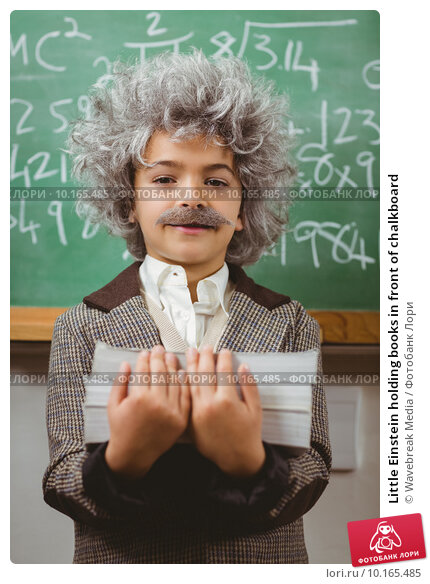 Купить «Little Einstein holding books in front of chalkboard», фото № 10165485, снято 8 июля 2015 г. (c) Wavebreak Media / Фотобанк Лори
