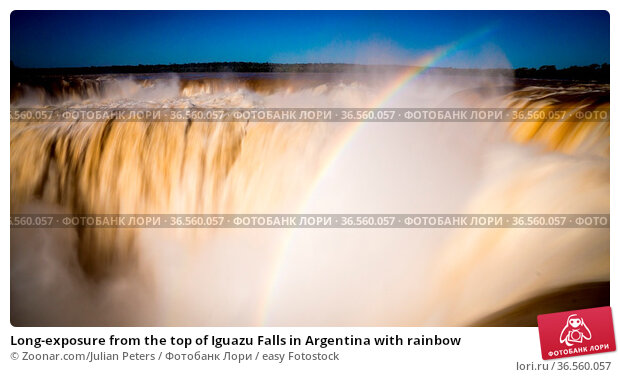 Long-exposure from the top of Iguazu Falls in Argentina with rainbow. Стоковое фото, фотограф Zoonar.com/Julian Peters / easy Fotostock / Фотобанк Лори
