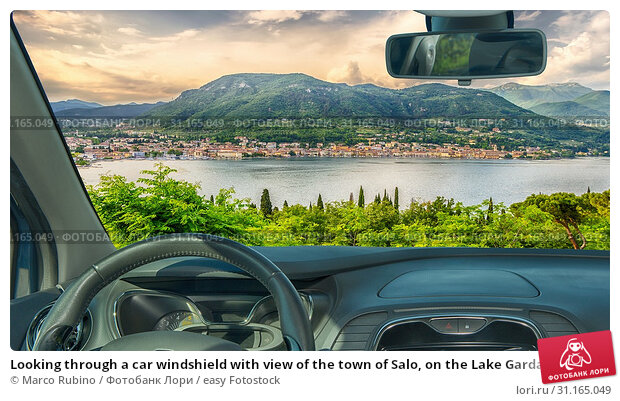 Купить «Looking through a car windshield with view of the town of Salo, on the Lake Garda, Italy», фото № 31165049, снято 28 января 2018 г. (c) easy Fotostock / Фотобанк Лори