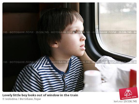 Купить «Lovely little boy looks out of window in the train», фото № 29536745, снято 29 августа 2018 г. (c) ivolodina / Фотобанк Лори