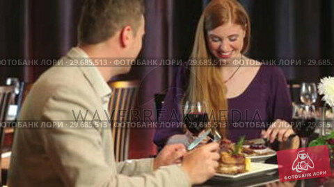 Купить «Loving couple talking while having dinner together », видеоролик № 29685513, снято 5 июня 2013 г. (c) Wavebreak Media / Фотобанк Лори