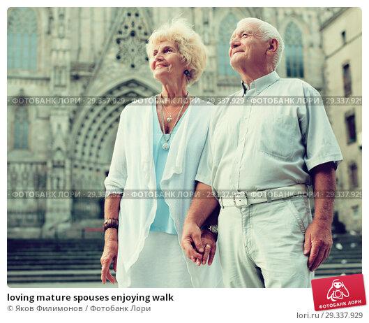 Купить «loving mature spouses enjoying walk», фото № 29337929, снято 27 августа 2017 г. (c) Яков Филимонов / Фотобанк Лори