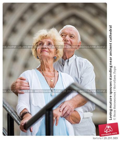 Купить «Loving mature spouses standing near ancient cathedral», фото № 28291989, снято 20 января 2019 г. (c) Яков Филимонов / Фотобанк Лори
