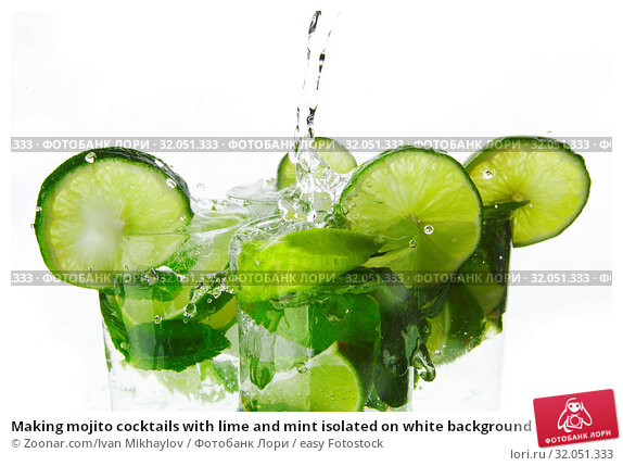 Making mojito cocktails with lime and mint isolated on white background. Стоковое фото, фотограф Zoonar.com/Ivan Mikhaylov / easy Fotostock / Фотобанк Лори