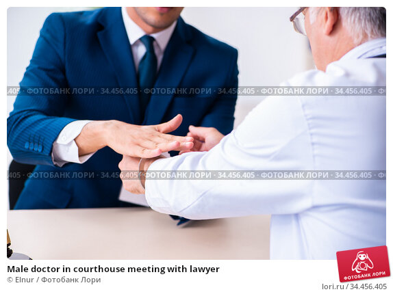 Male doctor in courthouse meeting with lawyer. Стоковое фото, фотограф Elnur / Фотобанк Лори